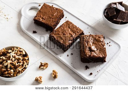 Homemade Dark Chocolate Brownies With Walnuts On White Table. Delicious Bitter Sweet And Fudge. Choc