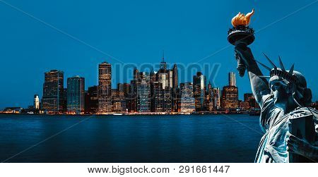 Symbols Of New York. Manhattan Skyline And The Statue Of Liberty, New York City
