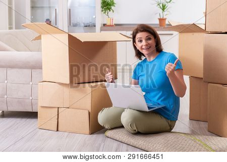 Middle-aged woman moving to new flat