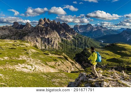 Male Asian Hiker Looking At Majestic View Of Dolomites Mountain Range In Tre Cime Di Lavaredo Loop T