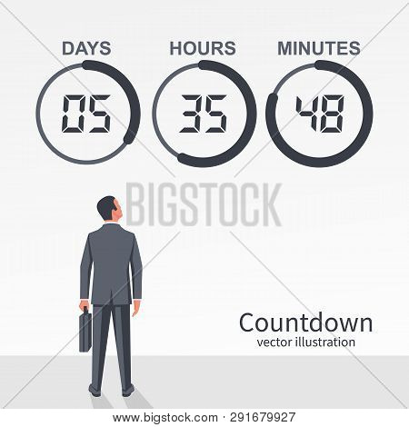 Businessman Looks At The Countdown Clock With Pie Diagram. Counter Timer. Digital Scoreboard Of Day