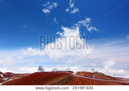 Observatories on top of Mauna Kea mountain peak. Astronomical research facilities and large telescope observatories located at the summit of Mauna Kea on the Big Island of Hawaii, United States poster