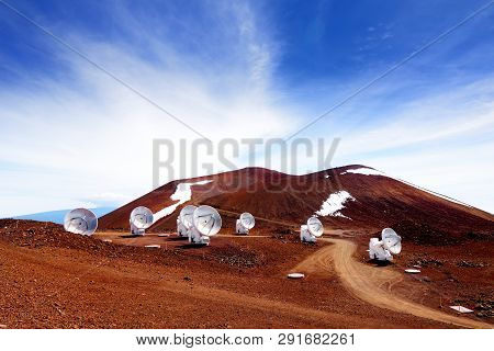 Observatories On Top Of Mauna Kea Mountain Peak. Astronomical Research Facilities And Large Telescop