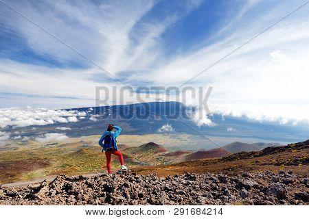 Tourist Admiring Breathtaking View Of Mauna Loa Volcano On The Big Island Of Hawaii.