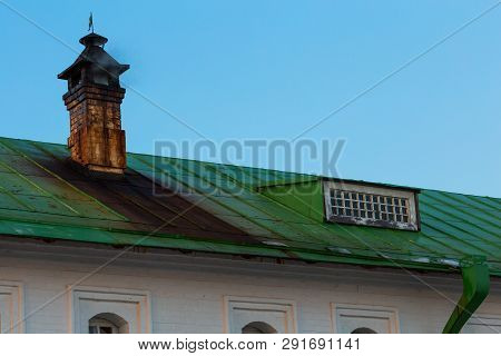 Green Tin Roof With Dirty Chimney With Tin Stains