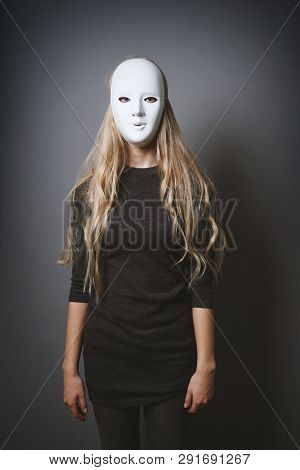 Mysterious Woman Hiding Face And Identity Behind Plain White Mask