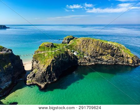 Carrick-a-rede Rope Bridge, Famous Rope Bridge Near Ballintoy In County Antrim, Linking The Mainland
