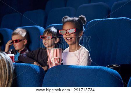Cheerful, Joyful Children Sitting In Cinema Theatre, Enjoying Movie Or Cartoon. Kids Wearing In 3d G