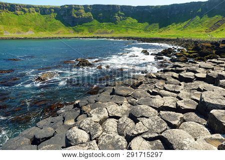 Giants Causeway, an area of hexagonal basalt stones, created by ancient volcanic fissure eruption, County Antrim, Northern Ireland. Famous tourist attraction, UNESCO World Heritage Site. poster
