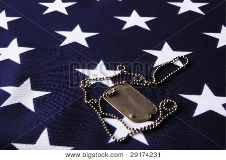 Dog tag on American Flag