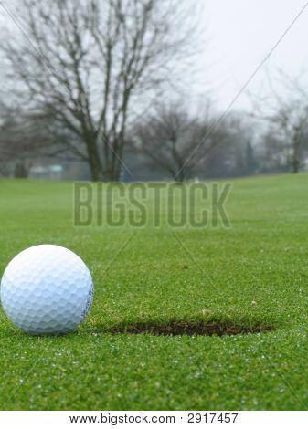 Ball Beside Hole On Green