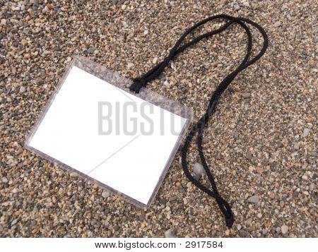 White Badge On A Cord