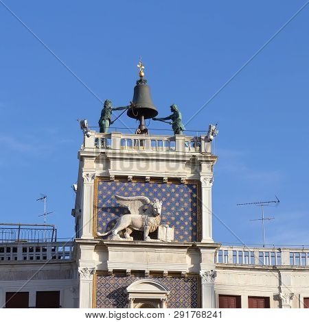 Venice/italy- April 16, 2018: Clock Tower With Winged Lion And Two Moors Striking The Bell At St. Ma