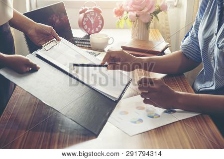 Working Woman Or Business Women Viewing Summary And Annual Report At Office.financial Adviser Planni