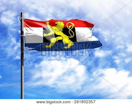 National Flag Of Benelux On A Flagpole In Front Of Blue Sky.
