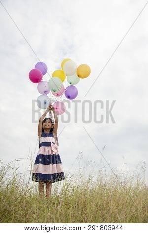 Let It Go,freedom Hand And Release Concept.birthday Balloon Holding By Happy Cute Child In Summer Ca