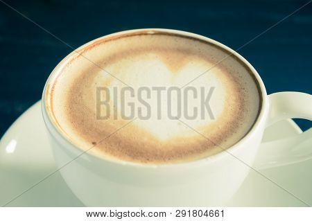 Vintage Heart Shape Froth Milk Latte Art In White Coffee Cup Zoom On Black Wood Table. Heart Shape F