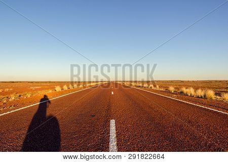 Red Straight Road With Red Dessert On The Stuart Highway North Of Copper Pedy, South Australia,