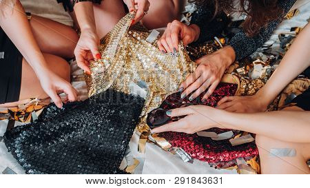 Party Fashion Luxury. Girls Hangout Plans. Shiny Sequin Dresses In Women Hands. Great Time Together.