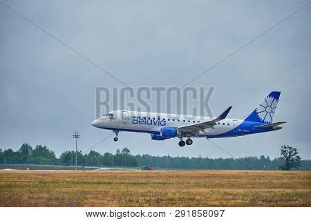 MINSK, BELARUS - JUNE 15, 2018: Belavia belarusian airlines flight Embraer E175 plane landing on runway in National Airport Minsk