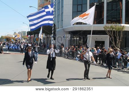 Limassol, Cyprus, March 25th, 2019: Bearers Of National Flags Of Greece And Cyprus Marching Along Th