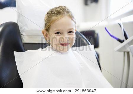 Smiling Little Girl In The Dental Office. Prevention, Pediatric Dental Care Concept.