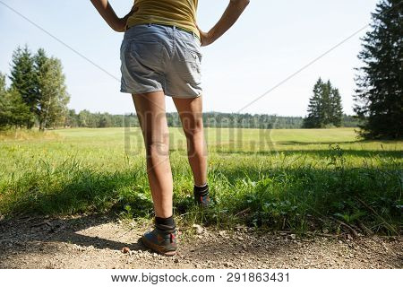 Woman With Painful Varicose Veins On Legs Resting On A Walk Through Nature. Varices, Spider Veins Pr
