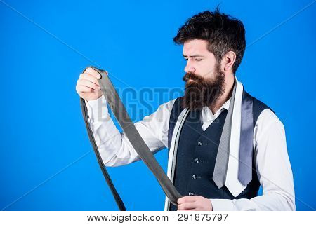 This Grey Tie Is Just The Accessory. Brutal Hipster Holding Luxury Tie Collection. Bearded Man Choos