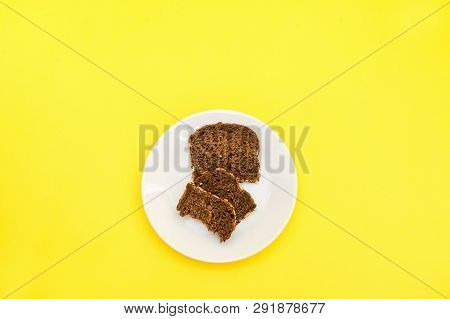 Sliced Rye Bread On The White Plare And Yelow Background. Whole Grain Rye Bread With Seeds