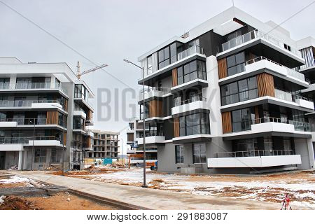 Construction Works Of Modern Low-rise Residential Buildings. Construction Site At The House. Cranes,