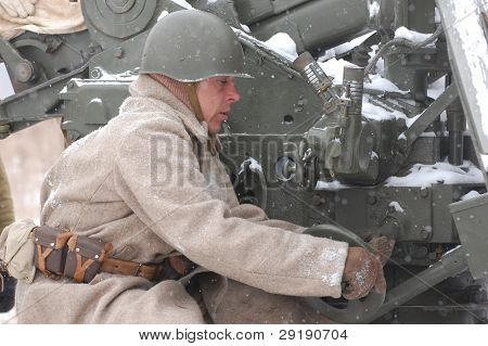 KIEV, UKRAINE - FEB 20: Member of military history club RedStar wears historical Soviet uniform during historical reenactment of WWII,February 20, 2011 in Kiev, Ukraine