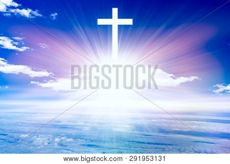 Heavenly Cross . Religion Symbol Shape .  Dramatic Nature Background  . Glowing Cross In Sky . Happy