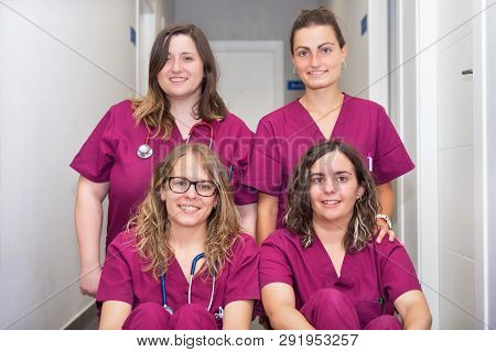 Cheerful Woman Veterinary Team At Animal Hospital.