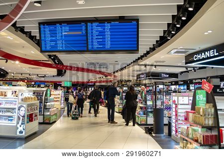 Lyon, France - 16 March 2019: Travelers In Saint Exupery Airport, Lyon, Moving Through The Isles Of