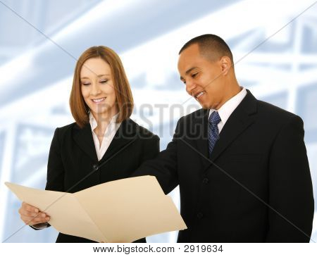 Business Team Reviewing Folder