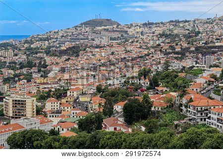 Panoramic At Residential District In Funchal Against Blue Sky. Portuguese Island Of Madeira