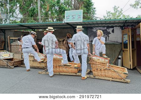 Monte (funchal), Portugal - 17 September, 2018: The Toboggan Drivers With Their Basket Cars Waiting