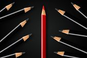 Business concept of disruption, leadership or think different; red pencil dividing group of black pencils; minimal concept flat lay from above on black background poster