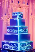 Beautiful tiered white cake wedding, decoration. Professional. Celebration, wedding, birthday, party, engagement, cakes. Close up of cake and blur background, selective focus. poster