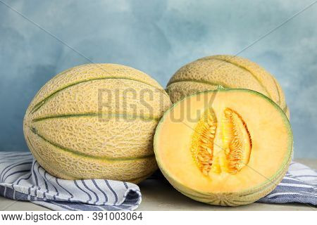Tasty Fresh Melons On Light Grey Table