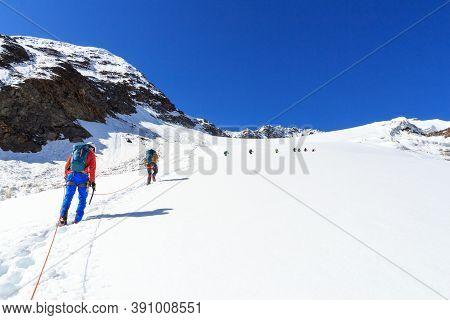Rope Team Mountaineering With Crampons On Glacier Sexegertenferner Towards Sexegertenspitze And Moun
