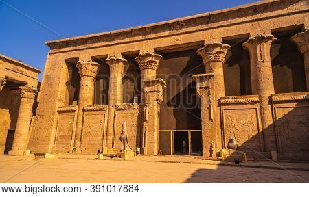 Facade With Drawing Of Pharaohs Of The Temple Of Edfu In The City Of Edfu, Egypt. On The Bank Of The