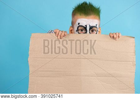 Discouraged Child Holding Blank Protest Cardboard With Free Space Isolated On Blue Background. Socia