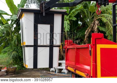Bucket Truck Of A Crane. Red Truck With White Picker Crane Parked On The Side Of The Road