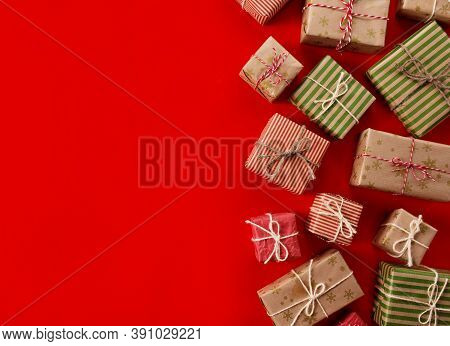Christmas Presents Gifts On A Red Background. Simple, Classic Red And White Wrapped Gift Boxes With