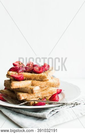 French Toast With Strawberries And Maple Syrup. Tasty Breakfast Scene Or Dessert With Toast, Strawbe