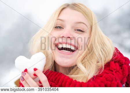 Girl In Mittens Hold Snowball. Portrait Of A Happy Woman In The Winter. Cheerful Girl Outdoors. Cute