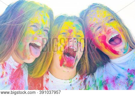 Teenager Friends With Dry Colors. Drycolors. Teenage School Friends Having Fun Piggybacking Outdoors