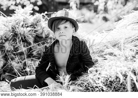 Portrait Of A Cheerful Boy Lying In A Hay. Sale For Entire Autumn Collection, Incredible Discounts A