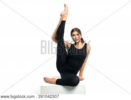 Beautiful Athletic Young Girl Gymnast In Sportswear, Training, Element Of Gymnastics, Performs Exerc